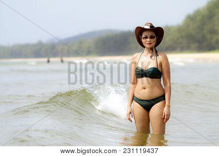 Woman Shape Sexy Show Bikini And Hat On Beach At Bang Beot Beach, Chumphon Province Thailand