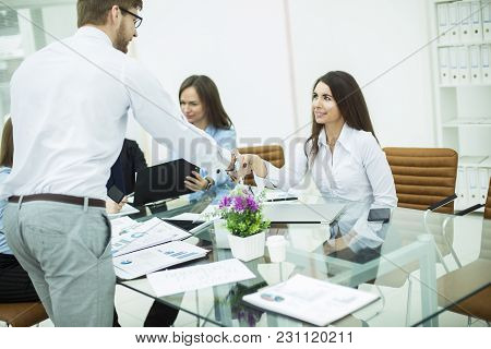 Handshake With A Senior Manager And A Client At A Business Meeting In A Modern Office