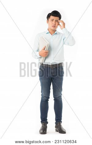 Portrait Of Adult Asian Student Holding Books