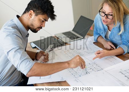 Office Coworkers In Business Meeting Discussing Project Plans