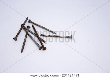 Some Rusty Nails On The White Background