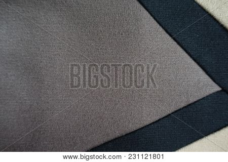 Gusset Of Grey Fabric Sewn To Beige And Black Fabric