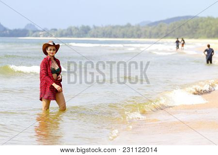 Women With Hat Relax Daylight On Beach At Bang Beot Beach, Chumphon Province Thailand