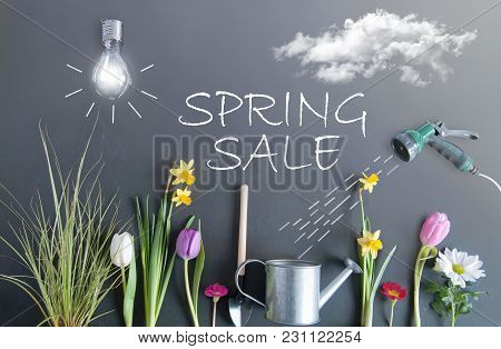 Spring Sale Flower Bed Garden With Clouds, Light Bulb As The Sun, And Hose Pipe With A Sketch Of Wat