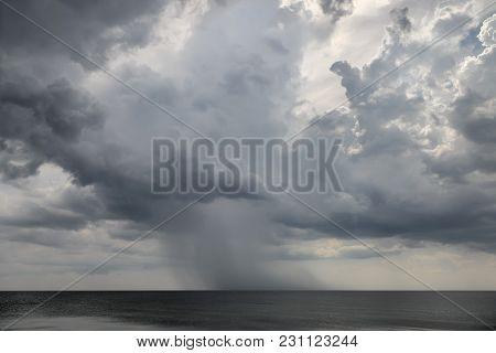Rainy Weather Over The Sea. The Approaching Shower Over The Black Sea.