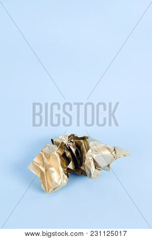 A Ball Of Crumpled Paper Painted In Gold. Minimal Color Still Life And Quirky Photography
