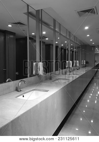 Interior Design Of Public Wash Basin And Automatic Faucet In Modern Hotel Or Restaurant, Black And W
