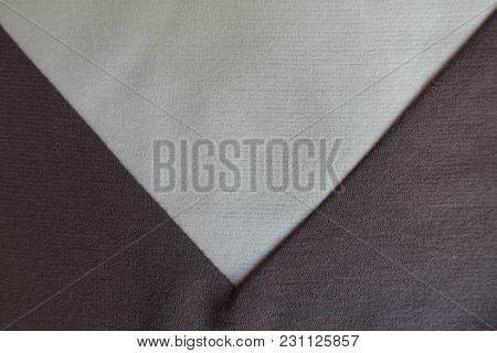 Ivory Triangular Gusset Sewn To Brown Fabric