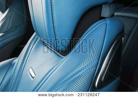 Modern Luxury Car Inside. Interior Of Prestige Modern Car. Comfortable Leather Red Seats. Blue Perfo