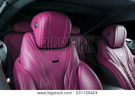 Modern Luxury Car Inside. Interior Of Prestige Modern Car. Comfortable Leather Red Seats. Pink Perfo