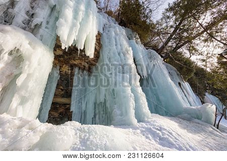 Ice Caves And Ice Curtains Form Along The Pictured Rocks Escarpment On Sand Point Road In Munising M
