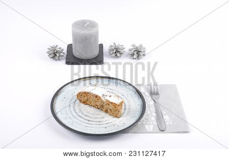Colorful And Crisp Image Of Christmas Stollen On Plate With Christmas Decoration