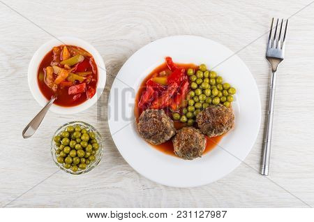 Fried Beef Meatballs With Lecho And Green Peas In Plate, Bowls With Peas And Sweet Pepper, Fork On W