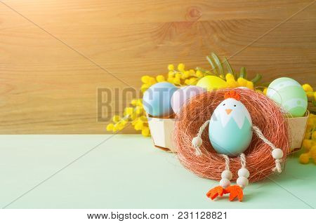 Easter Background. Easter Chicken And Easter Eggs In The Box Near The Mimosa Flowers, Free Space For