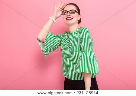 Portrait Of Attractive Cheerful Businesswoman With Hair Bun In Striped Blouse And Eyeglasses With Ha