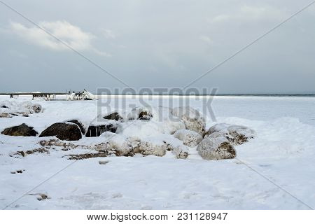 Frozen Pier On The Sea. Denmark. Baltic Sea. Natural Phenomena. Seascape