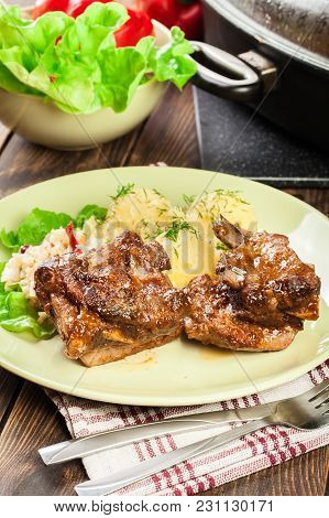 Pork Spare Ribs Served With Mashed Potatoes And Sauce. Ready For Eat