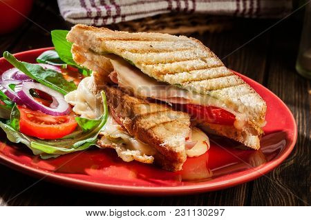 Toasted Panini With Ham, Cheese And Tomato Sandwich