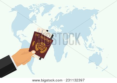 Passport With Boarding Pass In Hand. The Hand Holds A Passport Against The Background Of The World M