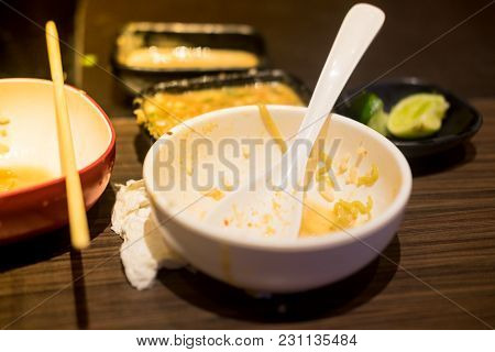 Empty Dishes After Eating On A Wooden Table At Restaurant