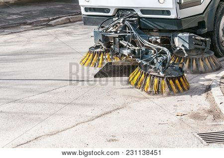 Sweeper Machinery. Street Sweeper Washing Garbage And Junk From Walkway And Road With Water And Clea