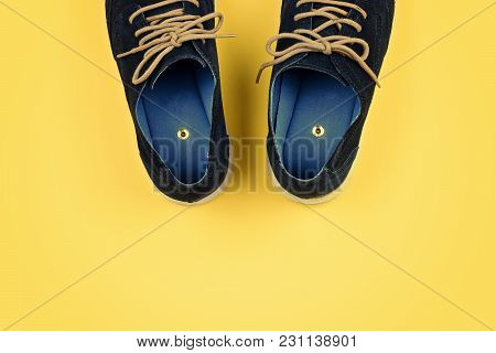 Men's Shoes With Paper Pins On Yellow