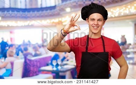 Portrait Of Chef Gesturing, Indoors