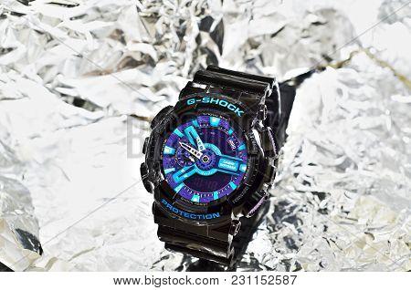 Snezhnoye, Ukraine - 07 March 2015: G-shock Watches Black Color With Blue Dial On Silver Luminous Ba