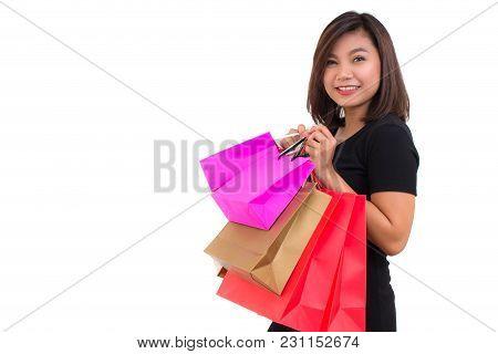 Beautiful Young Asian Woman Wear Black Shirt. Shopping Woman Holding Shopping Bags Looking To The Ca
