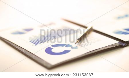 A Closeup Of A Business Financial Chart With Graphs. A Pen On Top. Represent Business Expenses, Grow
