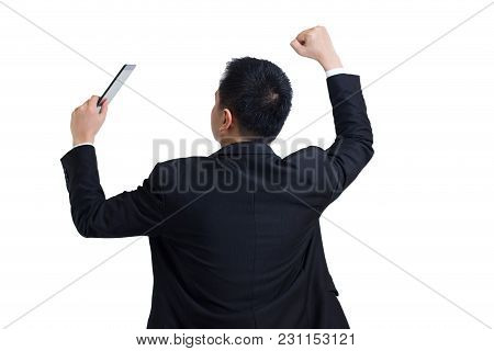 Modern Asian Businessman Wear Black Suit Stand Up To The Back And Holding Digital Tablet Celebrating