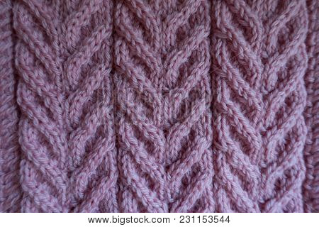 Relief Pattern On Pink Knitted Fabric From Above