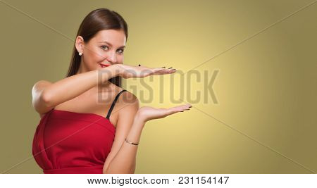 Young Woman Showing Hand Gap against a yellow background