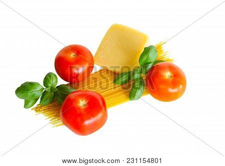 Raw Spaghetti Pasta With Fresh Tomatoes, Green Basil And Parmesan Cheese Isolated On White Backgroun