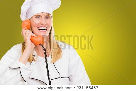 Female Chef Holding Telephone against a yellow background