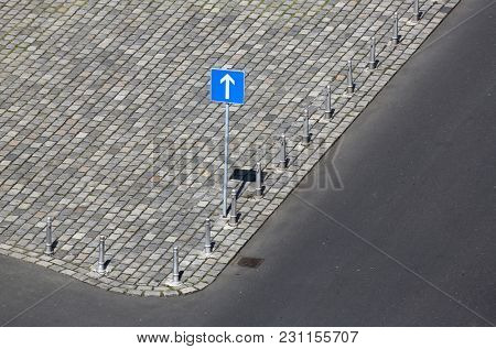 Road sign, one way traffic sign. Drive Straight Arrow