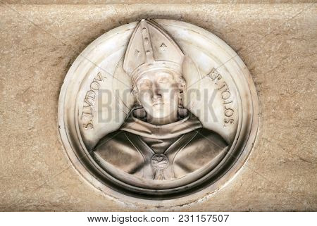 ROME, ITALY - SEPTEMBER 03: Saint Louis of Toulouse, bass relief in portico of church dei Santi XII Apostoli in Rome, Italy on September 03, 2016.