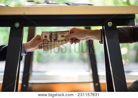 Corrupted Of Hand Businessman Sealing The Deal With A Handshake And Receiving A Bribe Money. Hands P