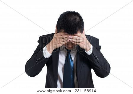 Businessman Under Stressed With A Headache Isolated On White Background. Disappointed Gloomy Young M