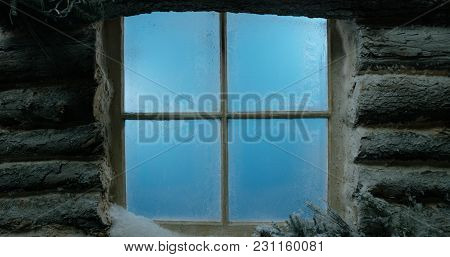 Frosted And Snow-covered Log Cabin Window Background