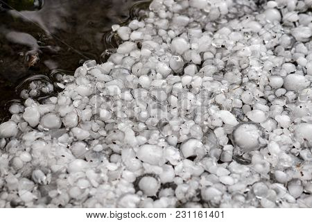 Hailstones On The Ground After Hailstorm, Hail Of Great Size, Hail Sized With A Larger Coin