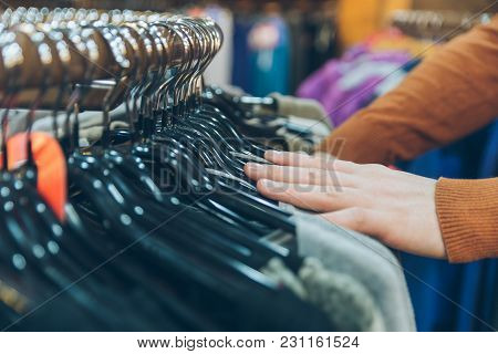 Man Hands Close Up Looking For Clothes In Store. Shopping Concept