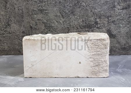 Bricks On The Gray Concrete Background. Copy Space. Top View