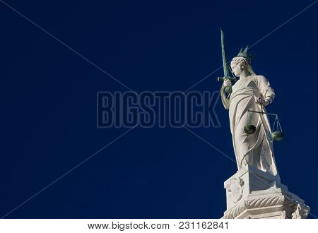 Goddess Of Justice Old Statue At The Top Of Doge Palace In Venice, Holding Balance Scales And Sword,