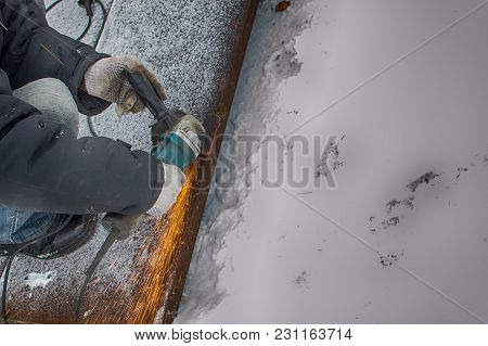 Man Conducts Welding Works Outdoors In Winter