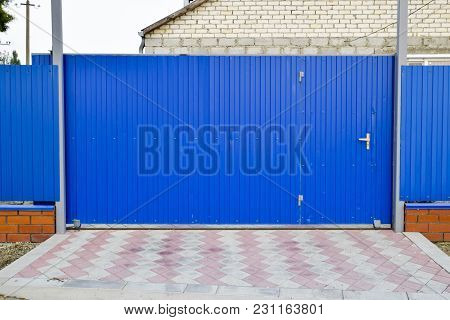 Fence And Gate From Sheets Of Blue Corrugated Metal