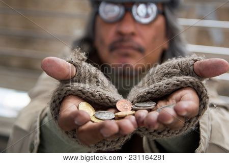 Homeless Senior Adult Man Sitting And Begging In Overpass