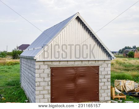 View Of The Garage In A Plot Of Land. Construction.