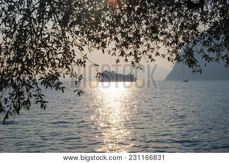 Little Island In The Middle Of A Sunset Reflexing On Iseo Lake - Montisola - Italy