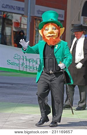 OTTAWA, CANADA - MAR. 10, 2012: Leprechaun in Saint Patrick's Day Parade in Ottawa, Canada.